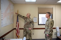 U.S. Air Force Staff Sgt. Corey Jones, 54th Operations Support Squadron tower watch supervisor, shows U.S. Army Brig. Gen. Eric Little, White Sands Missile Range commander, a map of Holloman's airfield, July 9, 2021, on Holloman Air Force Base, New Mexico. Little visited Holloman AFB to familiarize with local operations and tour partner units. (U.S. Air Force photo by Airman 1st Class Jessica Sanchez)