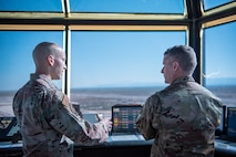 U.S. Air Force Staff Sgt. Corey Jones, 54th Operations Support Squadron tower watch supervisor, shows U.S. Army Brig. Gen. Eric Little, White Sands Missile Range commander, the air traffic control tower, July 9, 2021, on Holloman Air Force Base, New Mexico. Little visited Holloman AFB to familiarize with local operations and tour partner units. (U.S. Air Force photo by Airman 1st Class Jessica Sanchez)