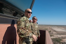 U.S. Air Force Col. Ryan Keeney, 49th Wing commander, and U.S. Army Brig. Gen. Eric Little, White Sands Missile Range commander, observe the airfield, July 9, 2021, on Holloman Air Force Base, New Mexico. Little visited Holloman AFB to familiarize with local operations and tour partner units. (U.S. Air Force photo by Airman 1st Class Jessica Sanchez)