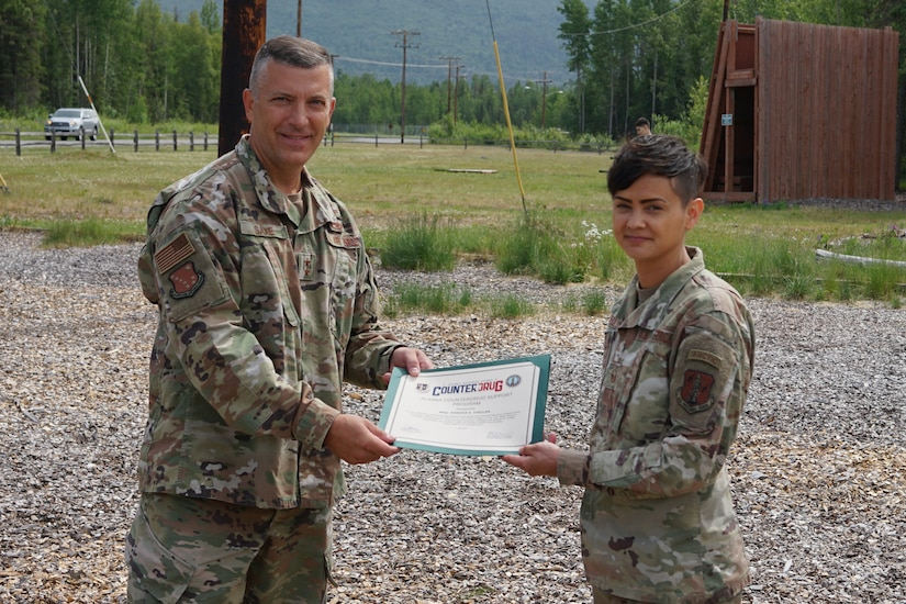 Maj. Gen. Torrence Saxe, commissioner for the Department of Military and Veterans Affairs and adjutant general of the Alaska National Guard, presents the National Guard Drug Demand Reduction Outreach Program of the Year for 2020 certificate to Master Sgt. Jennifer Theulen, Alaska National Counter Drug program coordinator, July 1, 2021.The Alaska National Guard Counter Drug Program was selected as the National Guard Drug Demand Reduction Outreach Program of the Year for 2020. The Counter Drug Program supports the Alaska National Guard efforts and initiatives to prevent drug abuse/misuse through prevention, education, outreach, and to detect and deter DoD military and civilian personnel from using illicit drugs or misusing prescription drugs.