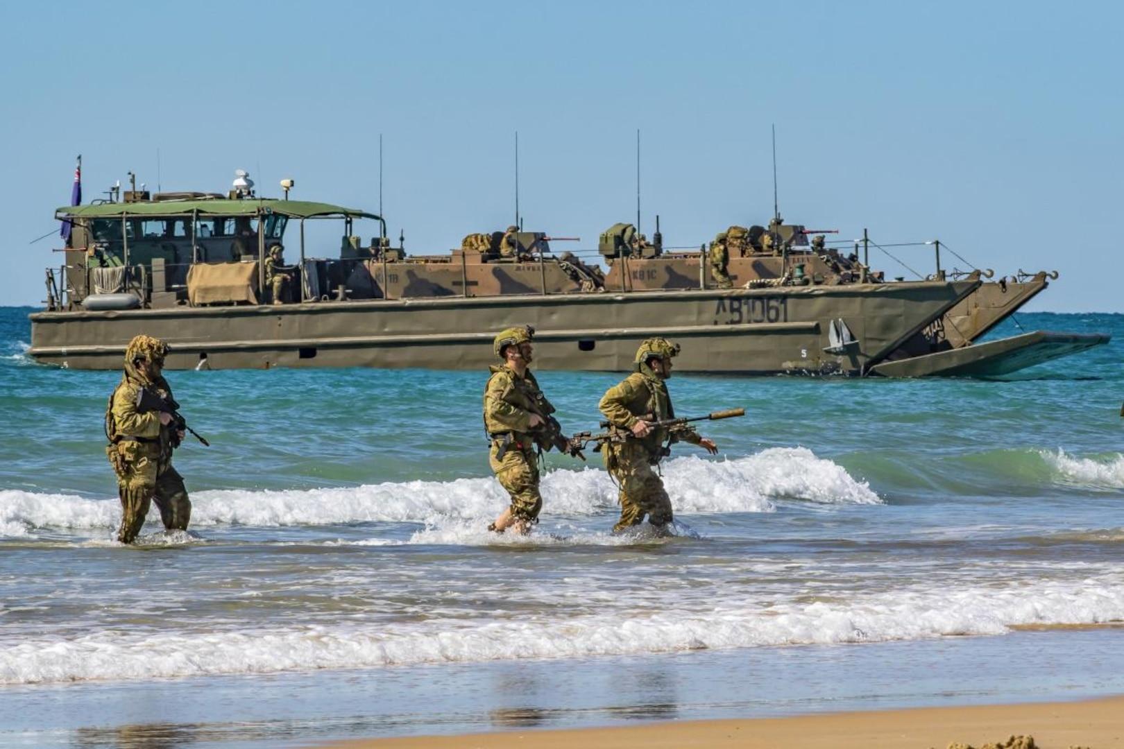 Australian Army soldiers, of 2nd Batallion, the Royal Australian Regiment, approach Langham Beach, Queensland, during Talisman Sabre 2019.