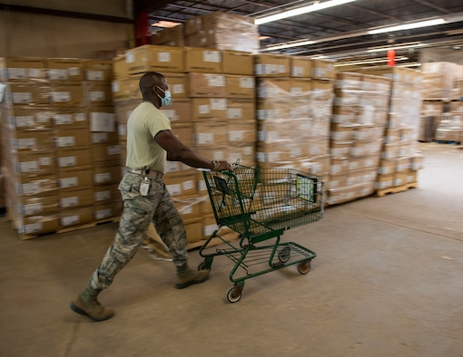 Airman 1st Class Abas Kallon from the 158th Fighter Wing, Vermont Air National Guard, retrieves personal protective equipment to fill an order at the Strategic National Stockpile Warehouse, Aug. 27, 2020. Airmen from across the 158th Fighter Wing have supported operations at the warehouse since March 2020.