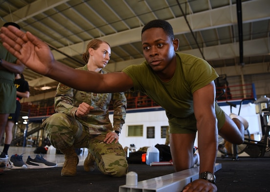 U.S. Air Force Capt. Danielle Langness, 17th Medical Group physical therapist, assesses a student's functional movements on Goodfellow Air Force Base, Texas, June 30, 2021. Students of the 312th Training Squadron were evaluated in physical and mental aspects before starting their technical training at the Louis F. Garland Department of Defense Fire Academy. (U.S. Air Force photo by Senior Airman Abbey Rieves)