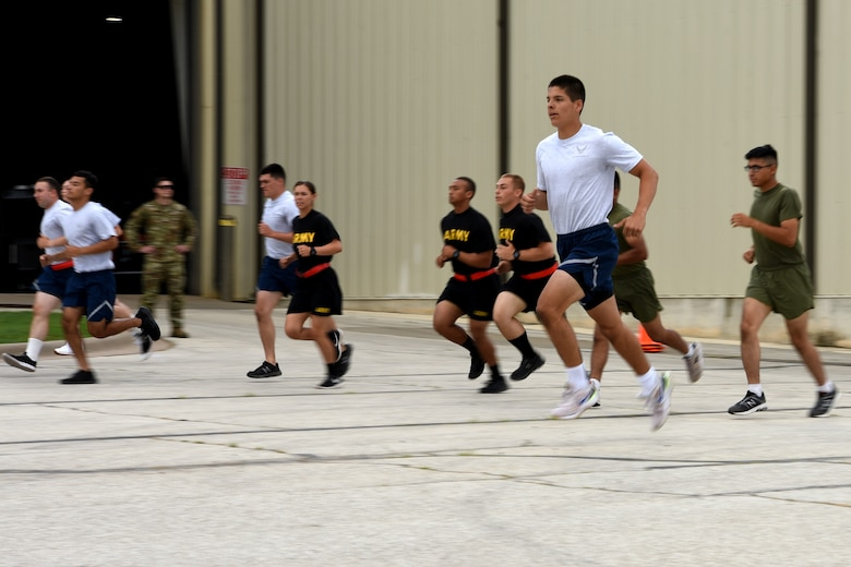 Joint service students assigned to the 312th Training Squadron run in a 20-meter pacer test for a medical evaluation, on Goodfellow Air Force Base, Texas, June 30, 2021. Goodfellow's Human Performance Team conducted several tests on the new students to mitigate training mishaps. (U.S. Air Force photo by Senior Airman Abbey Rieves)