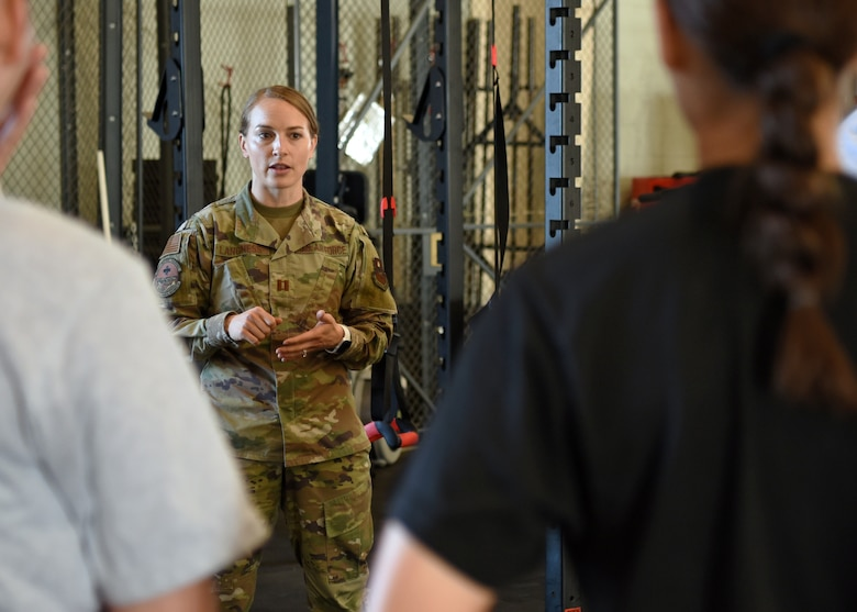U.S. Air Force Capt. Danielle Langness, 17th Medical Group physical therapist, briefs the 312th Training Squadron students, on Goodfellow Air Force Base, Texas, June 30, 2021. Langness coordinated with the fire academy and created a Human Performance Team to mitigate the number of students being medically removed or set back during their technical training. (U.S. Air Force photo by Senior Airman Abbey Rieves)