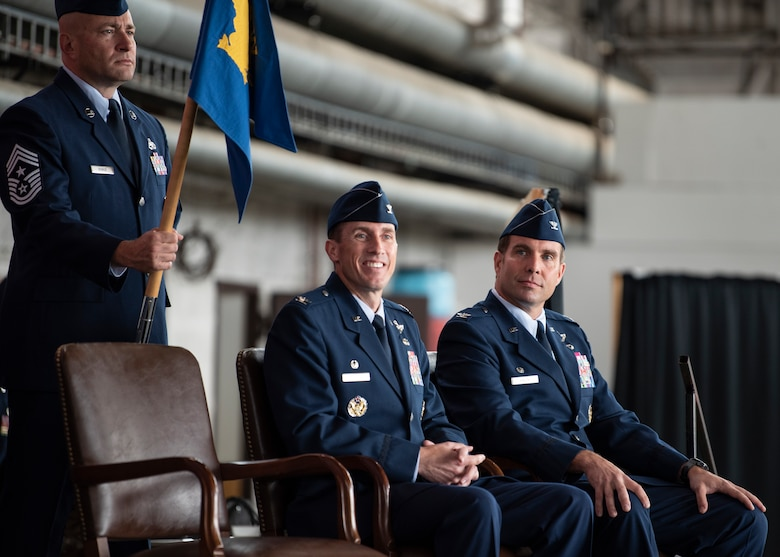 U.S. Air Force Chief Toby Roach, 52nd Fighter Wing command chief, (left), holds the guidon while Col. David Epperson, 52nd FW outgoing commander, (center), and Col. Leslie Hauck, 52nd FW incoming commander, listened to opening remarks from Maj. Gen. Randall Reed, Third Air Force commander, during the 52nd FW Change of Command ceremony July 15, 2021, on Spangdahlem Air Base, Germany. Hauck is a command pilot with more than 2,400 hours in the F-16 Fighting Falcon, including 285 combat hours in support of Operation Enduring Freedom. (U.S. Air Force photo by Staff Sgt. Melody W. Howley)