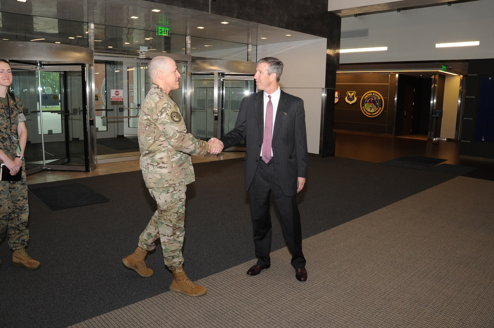 Dr Rhys Williamd Action Director, Defense Threat Reduction Agency, is greeted by LTG Bussier Deputy Commander, USSTRATCOM