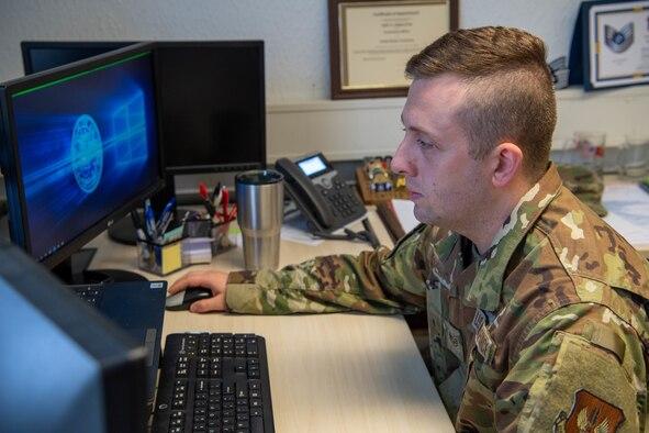 Airman looks at his computer