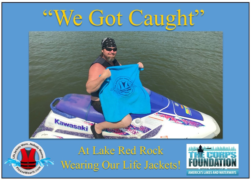 """This jet skier received a free beach towel when he was """"Caught"""" wearing his life jacket.  Towels were provided by The Corps Foundation."""