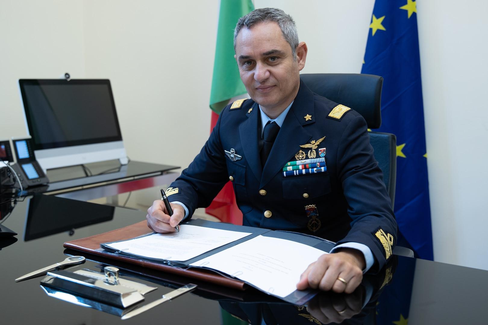 Italian Air Force general signs a memo.