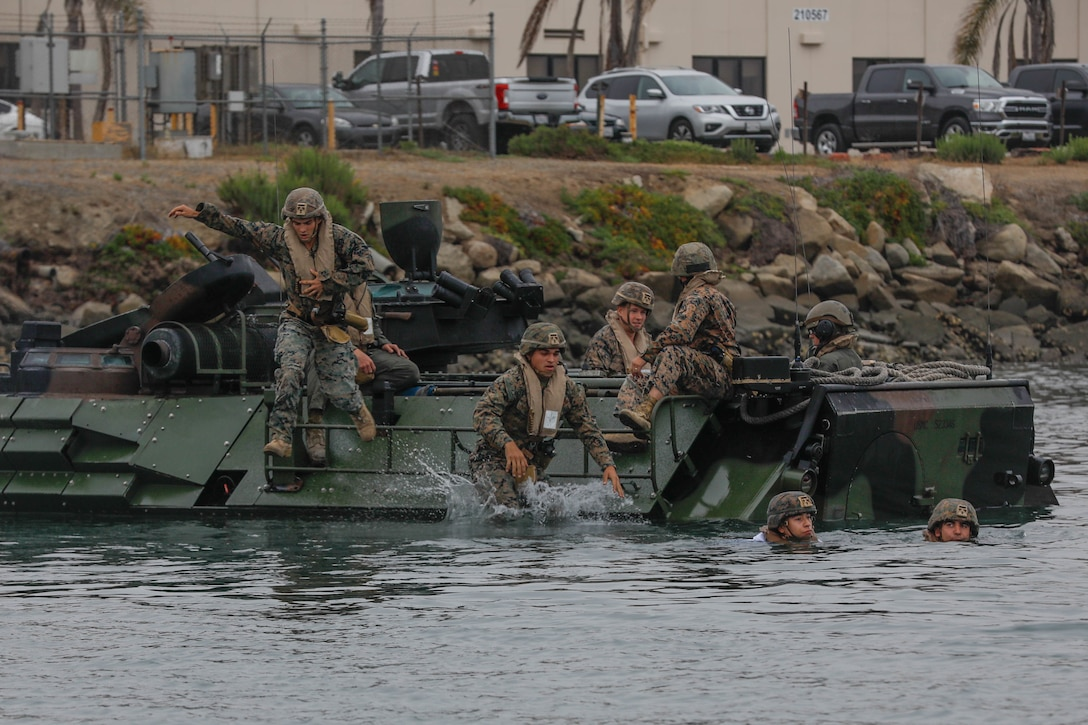 U.S. Marines with Co. A, 1st Battalion, 5th Marine Regiment, 1st Marine Division and Co. B, 3rd Assault Amphibian Battalion, 1st MARDIV, enter the Del Mar boat basin during AAV-P7/A1 amphibious assault vehicle training at Marine Corps Base Camp Pendleton, California, June 29, 2021. The training was conducted to ensure Marines are proficient with safety procedures for water operations.
