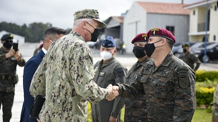 U.S. Navy Adm. Craig S. Faller, commander of U.S. Southern Command, visits with Guatemalan military members.
