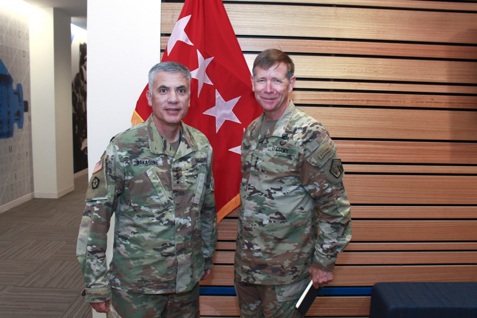 Photo By Sgt. 1st Class Teddy Wade   Gen. Paul Nakasone, commander of U.S. Cyber Command, Director of the National Security Agency and Chief of the Central Security Service (left), meets with Lt. Gen. Stephen G. Fogarty, commander of U.S. Army Cyber Command, (ARCYBER) during a visit and series of briefings with ARCYBER leaders at the command's headquarters at Fort Gordon, Ga., July 14, 2021. (Photo by Master Sgt. Teddy Wade)