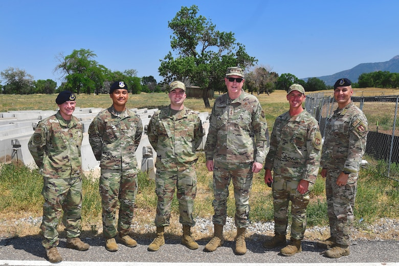 Defenders with the 75th Security Forces Squadron, Lt. Gen. Kirkland, and Chief Master Sgt. Flosi pose for a group photo.