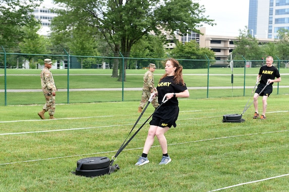 Staff Sgt. Alyssa N. Fowler, center, Human Resources Non-commissioned Officer, 84th Training Division, pulls a 90-pound sled during the Sprint-Drag-Carry portion of the Army Combat Fitness Test.