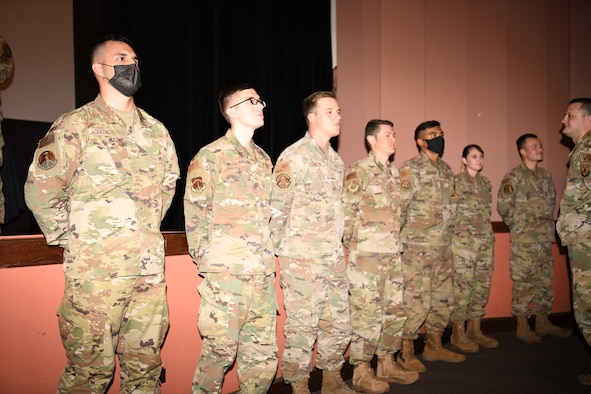 Members of the Raptor flight of ALS Class 21-F stand for recognition during their class graduation July 15, 2021, in the base theater on F. E. Warren Air Force Base, Wyo. ALS is a six-week course designed to prepare Airmen to assume supervisory duties as well as instruction in the practice of leadership and followership. Enlisted Airmen must graduate before supervising other Airmen. (U. S. Air Force photo by Airman 1st Class Charles Munoz)
