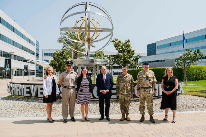 Leadership from the Space and Missile Systems Center gather for a photo with United Kingdom's Secretary of State for Defence, the Right Honourable Ben Wallace MP, and other members of the U.K. delegation before discussing international partnerships across the space domain at Los Angeles Air Force Base, California, July 15, 2021. The visit from the U.K. delegation aimed to gain a detailed understanding of the USSF's approach to space acquisitions while continuing its desire for ongoing bilateral engagement in support of shared military requirements through space. (U.S. Space Force photo by Staff Sgt. Luke Kitterman)