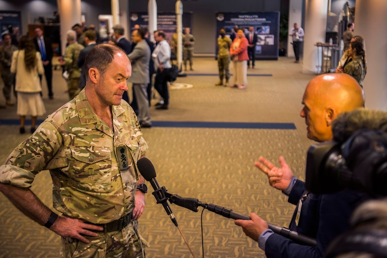 Gen. Sir Patrick Sanders, U.K. Strategic Command commander, conducts an interview with a member from media during a Space and Missile Systems Center overview presentation at the Gordon Conference Center on Los Angeles Air Force Base, California, July 15, 2021. Multiple media representatives from different U.K. news agencies attended the event. (U.S. Space Force photo by Staff Sgt. Luke Kitterman)