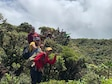 Airman 1st Class Genesaret Balladares,154th Security Forces Squadron member, leads a team of volunteers during a conservation event June 8, 2021, on Mount Kaala, Hawaii