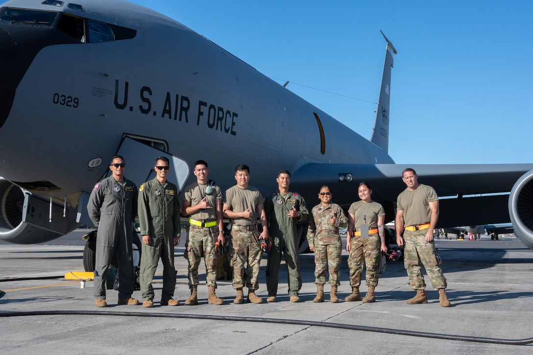 A Hawaii Air National Guard aircrew, maintenance team and chaplain gather in front of a KC-135 Stratotanker May 25, 2021, at Joint Base Pearl Harbor-Hickam, Hawaii. The all-Asian American and Pacific Islander crew flew with F-22 Raptors and a C-17 Globemaster III during a practice refueling mission in celebration of AAPI heritage month.