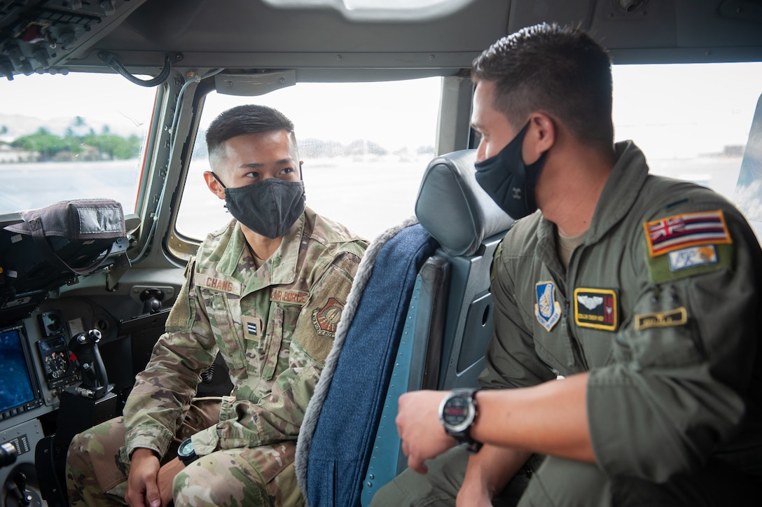 A Reserve Officers' Training Corps cadet receives a C-17 Globemaster III orientation briefing from a pilot from the 204th Airlift Squadron pilot May 25, 2021, at Joint Base Pearl Harbor-Hickam, Hawaii.