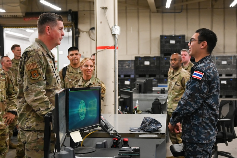 Lt. Gen. Kirkland speaks with 1st Lt. Terranuson while other Airmen look on in the background.