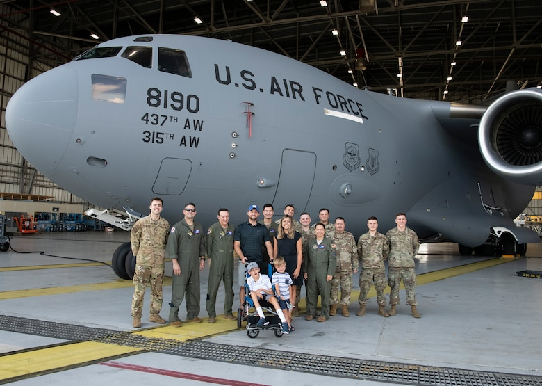 The Adkins family - Matt, Leslie, Braiden and Jace (center) pose for a group photo with aircrew and maintainers at Joint Base Charleston, South Carolina.