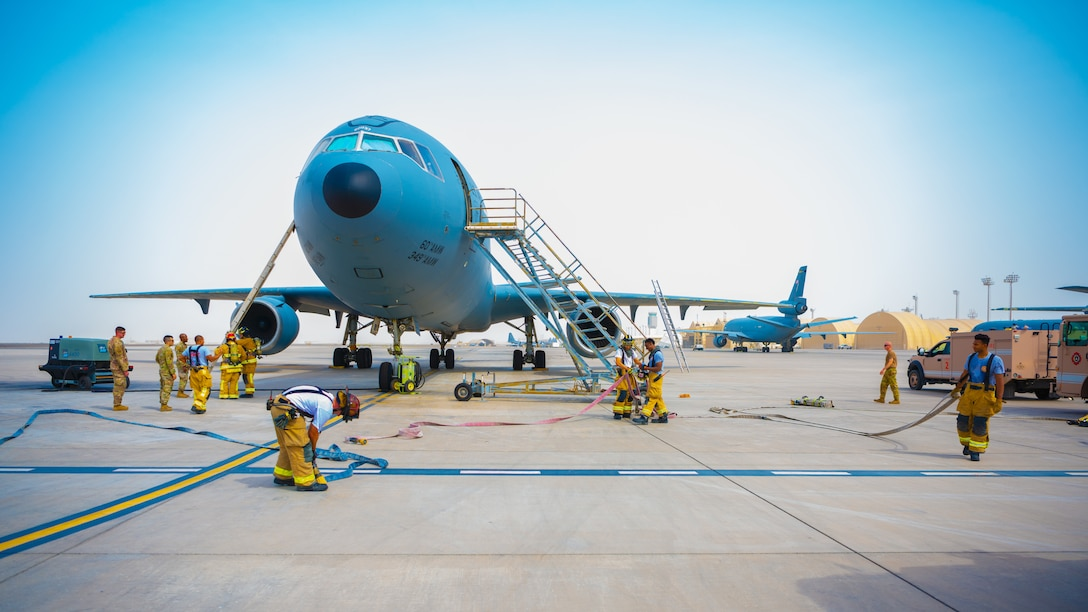 U.S. Air Force Airmen of the 380th Expeditionary Fire Department perform an exercise involving a KC-10 Extender aircraft at Al Dhafra Air Base, United Arab Emirates.