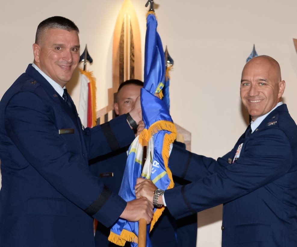 U.S. Air Force Col. Randolph Lake, right, incoming 101st Air and Space Operations Group (AOG) commander, accepts the ceremonial passing of the flag from Brig. Gen. Michael Valle, Air, Florida National Guard assistant adjutant general, and Florida Air National Guard commander, during an AOG change of command, Tyndall Air Force Base, July 14, 2021.