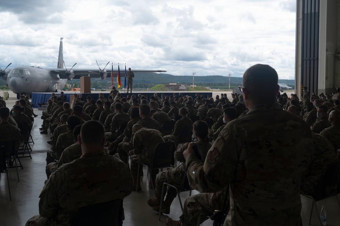 An Airman asks a question during an all call