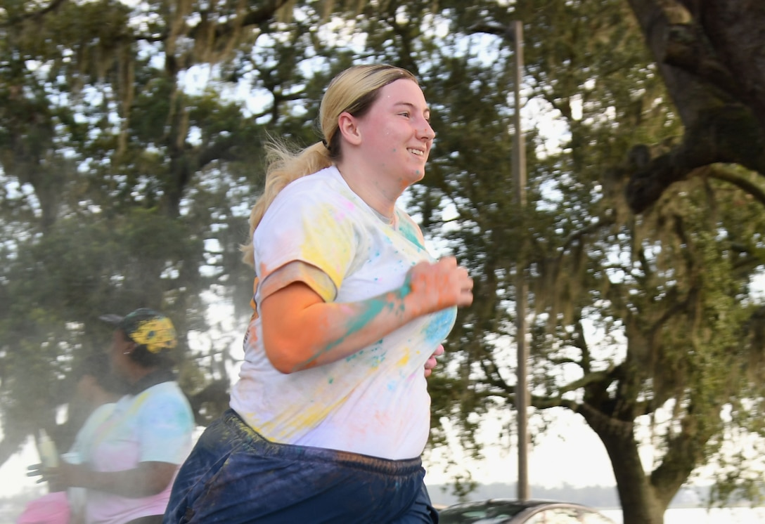 U.S. Air Force Senior Airman Kimberly Mueller, 81st Training Wing command information lead, participates in a 5K Color Run at Keesler Air Force Base, Mississippi, July 15, 2021. Keesler personnel participates in the 5K Color Run at Keesler Air Force Base, Mississippi, July 15, 2021. The run, hosted by the Keesler Airman's Council, Air Force Sergeants Association and the Wing 5/6, was held in recognition of suicide awareness. (U.S. Air Force photo by Kemberly Groue)