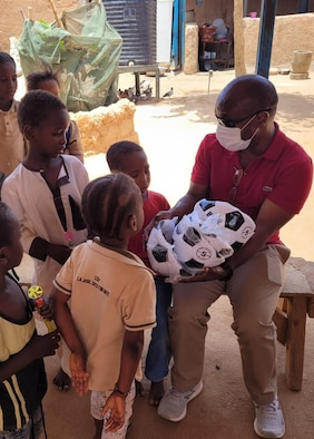 U.S. Air Force Capt. Guy Kagere, 435th Air Expeditionary Wing chaplain, donates supplies to children at an orphanage in Agadez City, Agadez, May 5, 2021.