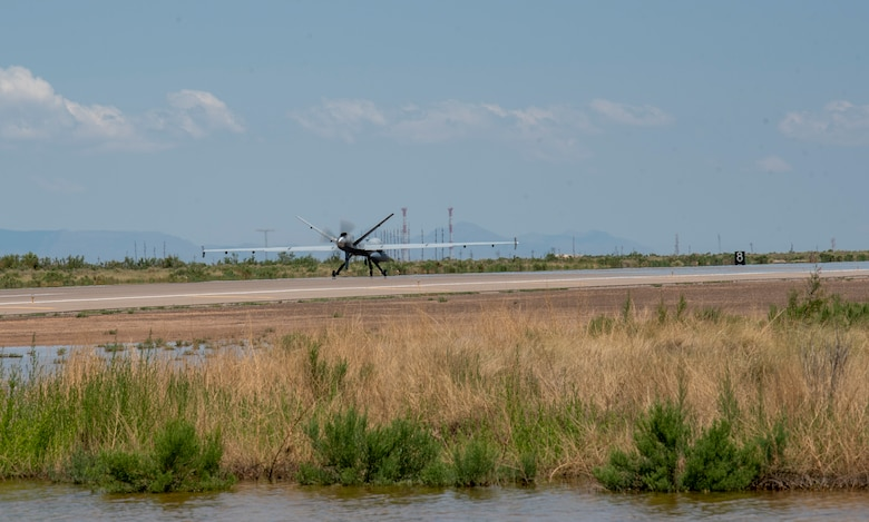 An MQ-9 Reaper from Creech Air Force Base, Nevada, prepares to take off from Holloman AFB, New Mexico, July 8, 2021. This is the first time an MQ-9 arrive at HAFB from a different base using a new automated landing and takeoff system without an aircrew. (U.S. Air Force photo by Airman 1st Jessica Sanchez)