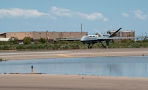 An MQ-9 Reaper from Creech Air Force Base, Nevada, lands at Holloman AFB, New Mexico, July 8, 2021. This is the first time an MQ-9 arrived at HAFB from a different base using a new automated landing and takeoff system without an aircrew. (U.S. Air Force photo by Airman 1st Class Jessica Sanchez)