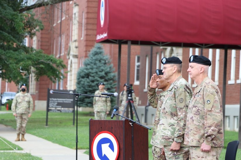 Maj. Gen. Michel M. Russell Sr., commanding general, 1st Theater Sustainment Command, releases authority of the unit to Col. Joseph Kurz, chief of staff, 1st TSC, after the change of command ceremony held July 13, 2021 outside of Fowler Hall in Fort Knox, Kentucky. Maj. Gen. Michel M. Russell Sr. assumed command of the 1st TSC from Maj. Gen. John P. Sullivan before an audience of current and former leaders, community members, family, and 1st TSC Soldiers. (U.S. Army Photo by Spc. Zoran Raduka, 1st TSC Public Affairs)