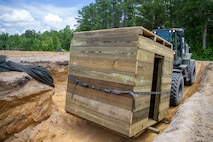 A U.S. Marine Corps TRAM 624KR Tractor with 8th Engineer Support Battalion, 2nd Marine Logistics Group, transports a Combat Operations Center during a field exercise on July 14, 2021 at Camp Lejeune, North Carolina. The Marines built an underground COC to hide from a simulated enemy in a contested environment. (U.S. Marine Corps photo by Cpl. Christian M. Garcia)