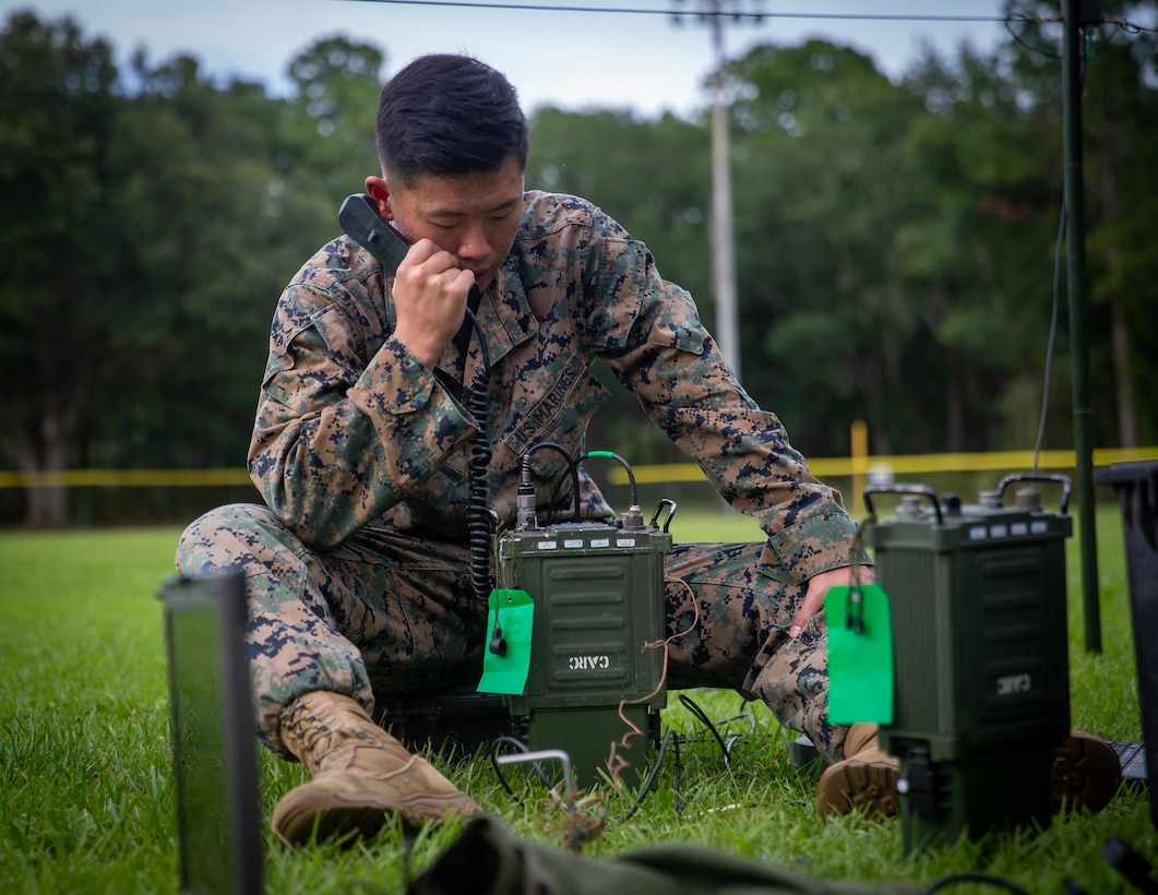 U.S. Marine Corps Cpl. Leo Yoon, a Rockville, Md., native and a transmissions systems operator with 1st Battalion, 2d Marine Regiment, 2d Marine Division (MARDIV), operates an AN/PRC-160(V) radio as part of the 2d MARDIV High-Frequency (HF) Competition on Naval Submarine Base Kings Bay, Ga., July 12, 2021. The competition enhanced HF transmission proficiency and capabilities to prepare Marines for future expeditionary conflicts where the area is either contested or degraded. (U.S. Marine Corps photo by Lance Cpl. Brian Bolin Jr.)