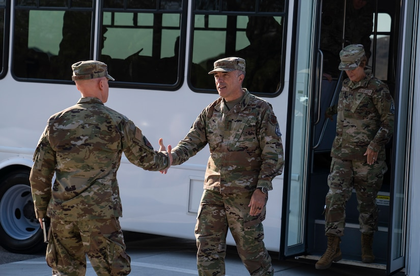 Col. Eric Schmidt, 432nd Wing/432nd Air Expeditionary Wing commander greets Lt. Gen. Robert Miller, Surgeon General of the Air Force and Space Force, at Creech Air Force Base.