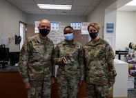 Lt. Gen. Robert Miller poses for a group photo in the Creech Medical Clinic.