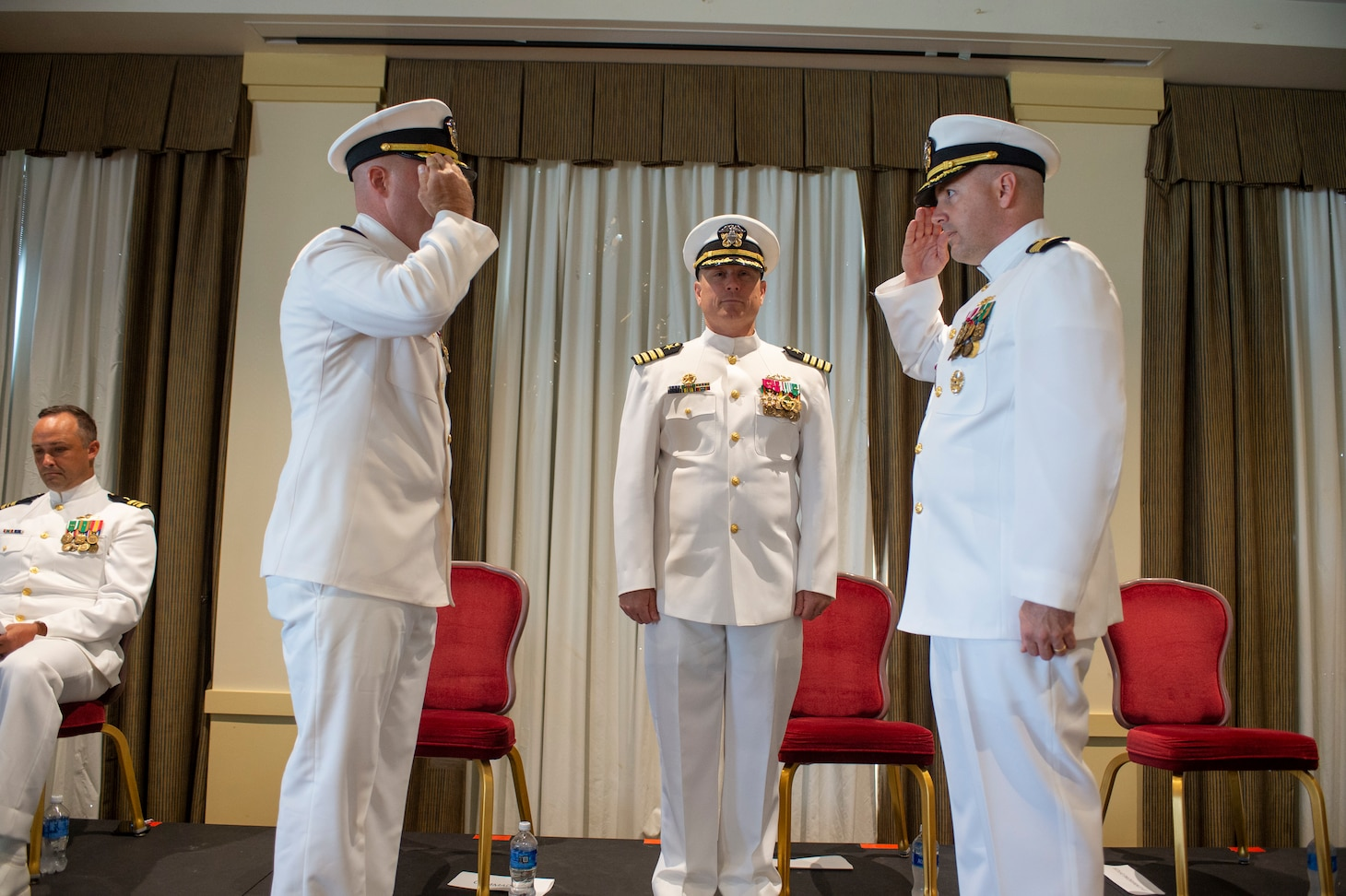 Cmdr. Jon Quimby, left, relieves Capt. Michael Delaney as commanding officer of the Virginia-class fast-attack submarine Pre-Commissioning Unit (PCU) Montana (SSN 794) during a change of command ceremony at Naval Station Norfolk, July 16, 2021.