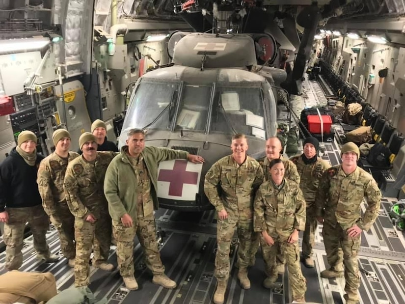 Members of Det. 1, Charlie Company, 2nd Battalion, 238th Aviation Regiment MEDEVAC leave Afghanistan on an Air Force C17 after their overseas deployment on Oct. 14, 2020