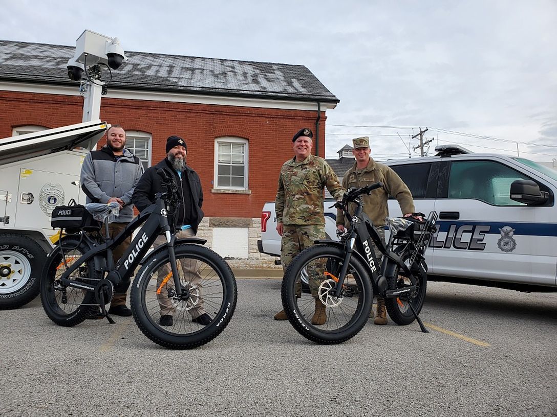 Department of the Air Force civilian police and Air National Guard members pose with electric bicycles delivered to Jefferson Barracks Air National Guard Station, St. Louis, Missouri, December 15, 2020. The newly-formed civilian police force will patrol the installation using bicycles and vehicles. (Courtesy Photo)