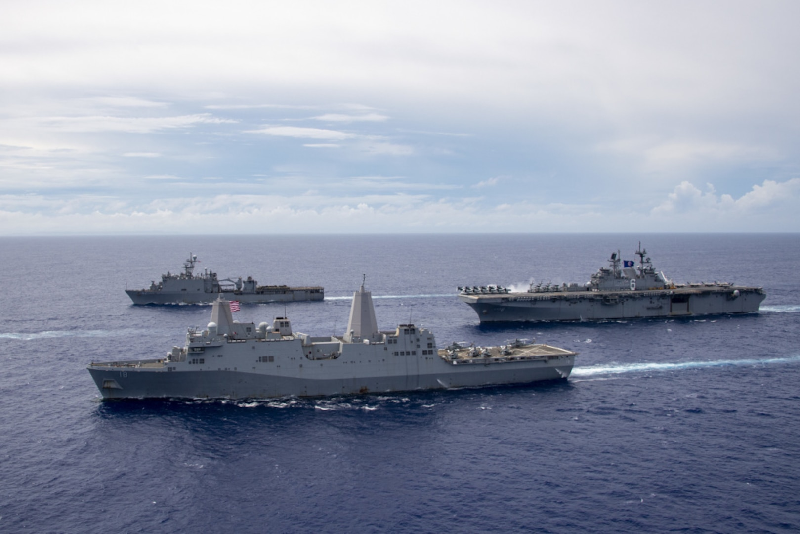 PHILIPPINE SEA (June 13, 2021) The America Amphibious Ready Group (ARG) sail in formation. Clockwise from right: USS America (LHA 6), USS New Orleans (LPD 18), USS Germantown (LSD 42). The America ARG, along with the 31st Marine Expeditionary Unit, is operating in the U.S. 7th Fleet area of operations to enhance interoperability with allies and partners and serve as a ready response force to defend peace and stability in the Indo-Pacific region.