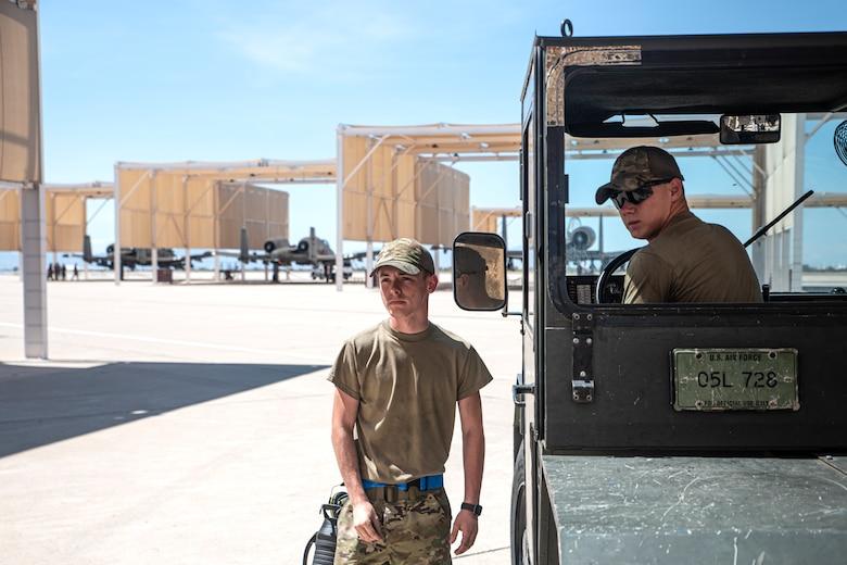 A photo of Airmen in a truck