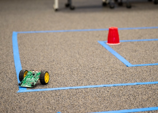 A small robot maneuvers through a maze during a Code Bot Course that was offered at Edwards Air Force Base, May 13. Project Code Bot graduated 10 remote students in May 2021 and is slated to conduct the next class August 16-20.