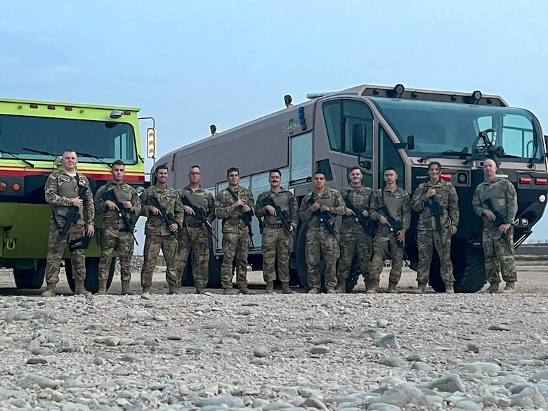 A quick reaction force, comprised of members of the 386th Expeditionary Civil Engineer Squadron, take a group photo at a forward operating base in Syria, May 22, 2021. The QRF are elite units, made up of Airmen from multiple squadrons trained in combat and evasion.