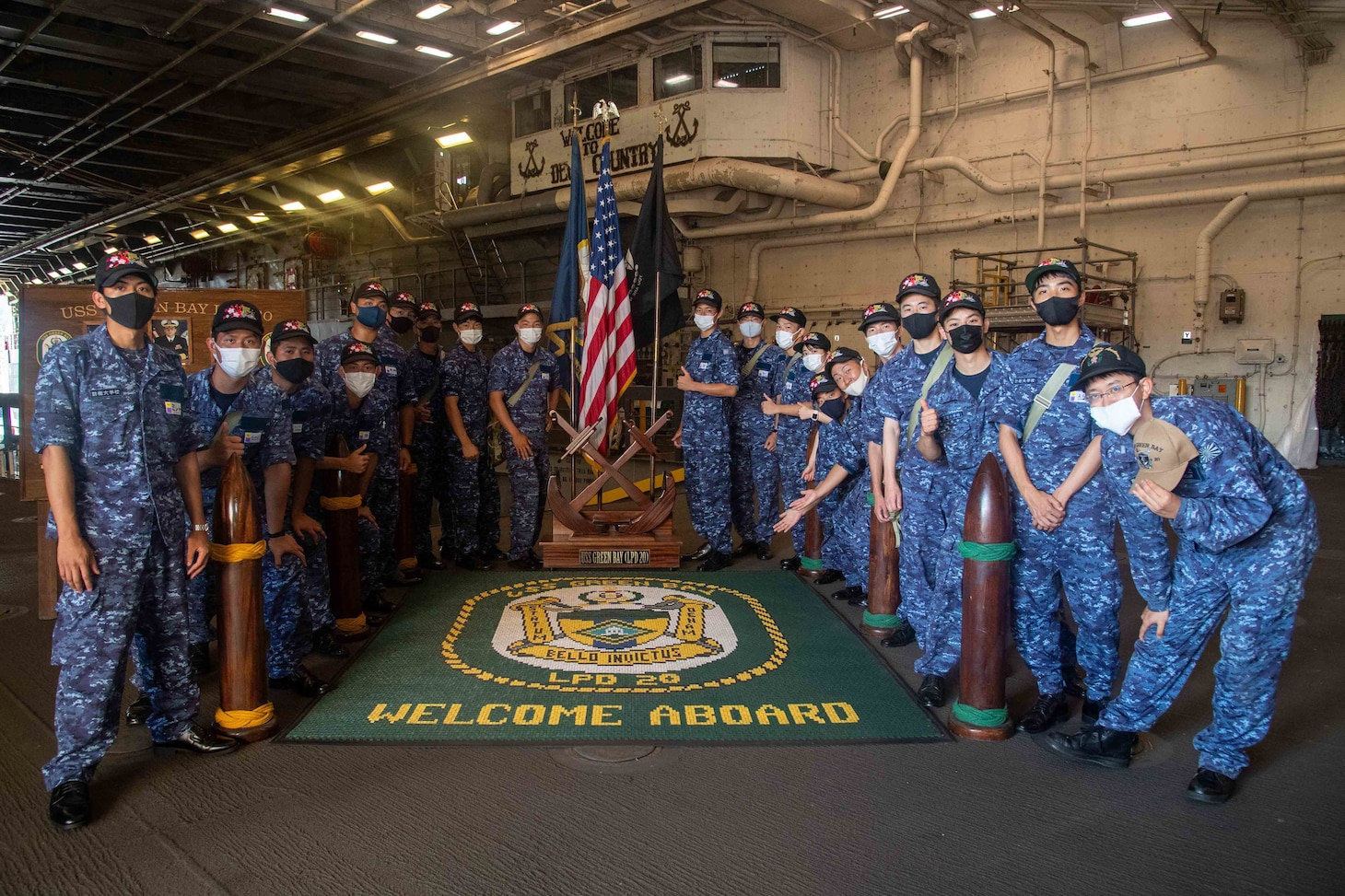 National Defense Academy of Japan cadets pose for a photo during a ship tour aboard the amphibious transport dock ship USS Green Bay (LPD 20).