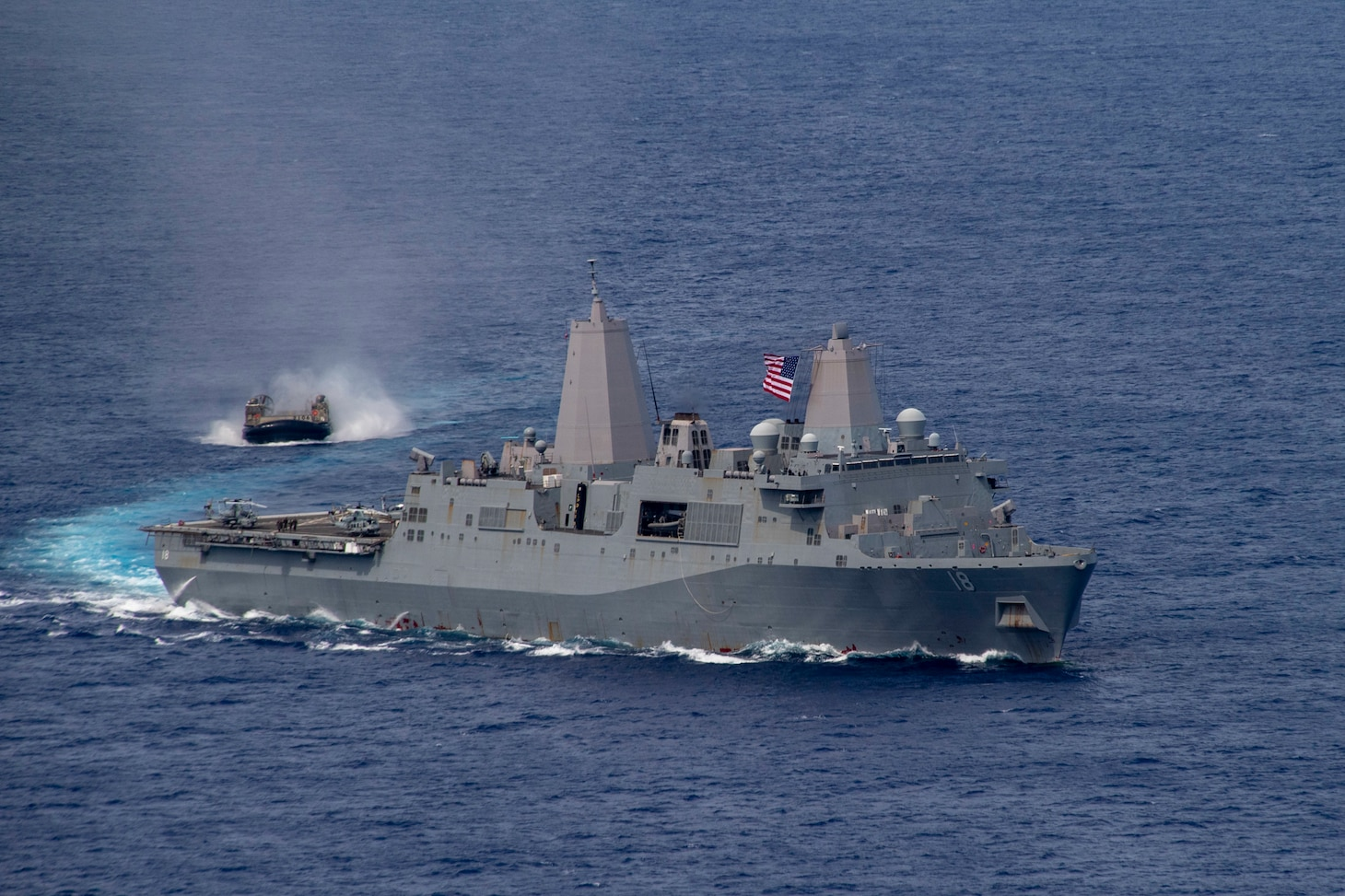 PHILIPPINE SEA (June 13, 2021) Amphibious transport dock USS New Orleans (LPD 19), right, sails alongside a Japan Maritime Self Defense Force landing craft, air cushion. The America Amphibious Ready Group, along with the 31st Marine Expeditionary Unit, is operating in the U.S. 7th Fleet area of operations to enhance interoperability with allies and partners and serve as a ready response force to defend peace and stability in the Indo-Pacific region.