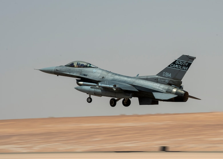 A U.S. Air Force F-16 Fighting Falcon takes off from a flightline at Prince Sultan Air Base, Kingdom of Saudi Arabia, to take part in a counter unmanned aerial system integration mission with joint and Royal Saudi aircraft, June 30, 2021. U.S. Air Forces Central aircraft regularly work with coalition and partner nations to test their collective counter-UAS capabilities to ensure the security and stability of regional airspace. (U.S. Air Force photo by Technical Sgt. Veronica Woodward)