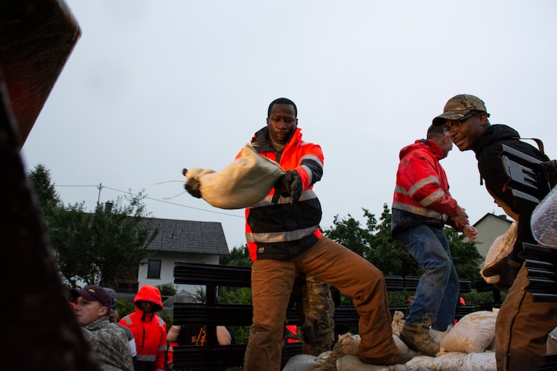 Members from the 52nd Civil Engineer Squadron from Spangdahlem Air Base, Germany, work with German first responders and community members to lay sandbags in the town of Binsfeld, Germany, July 14, 2021.